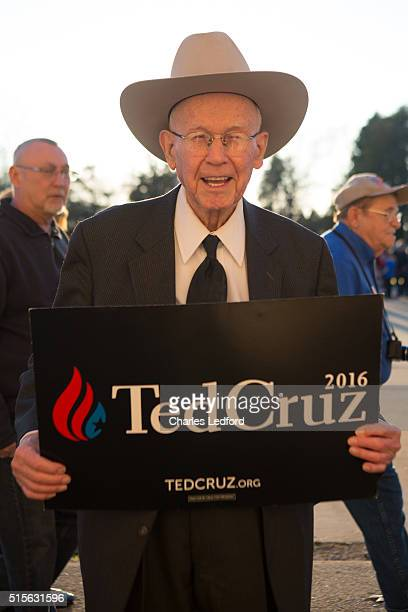 The Rev Wilson Douglas of Springfield Illinois poses with a US Senator Ted Cruz sign as guests walk into a campaign rally for the candidate on March...