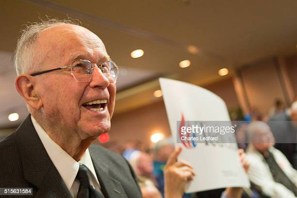 The Rev Wilson Douglas of Springfield Illinois reacts as US Senator Ted Cruz speaks at a campaign rally for the candidate on March 14 2016 in Decatur...