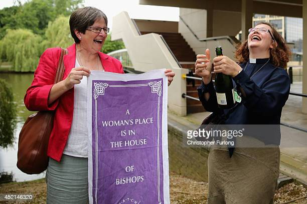 The Revd Dr Miranda ThrefallHolmes and Hilary Cotton celebrate with Champagne after the Church of England General Synod gave their backing to the...
