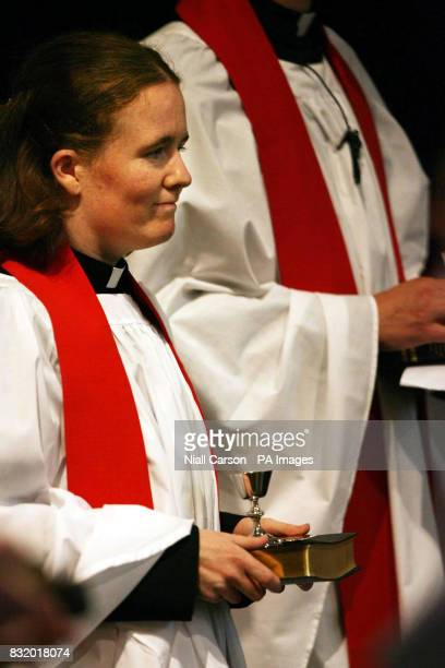 The Revd Elaine Dunne holds her bible chalace and paten after her ordination at a special Church of Ireland service at Christ Church Cathedral Dublin