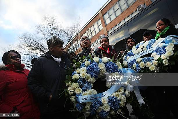 The Reverand Al Sharpton stands with Eric Garner's mother Gwen Carr and members of the National Action Network to lay wreaths and say a prayer at the...