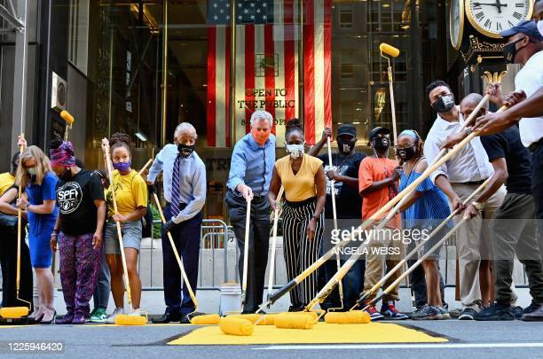 The Reverend Al Sharpton New York Mayor Bill de Blasio and his wife Chirlane McCray paint a new Black Lives Matter mural outside of Trump Tower on...