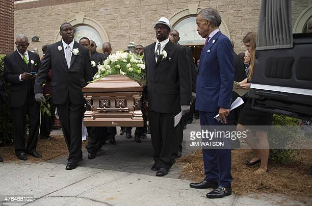 The Reverend Al Sharpton watches as pallbearers carry the casket holding Emanuel AME Church shooting victim Ethel Lance during her funeral at the...