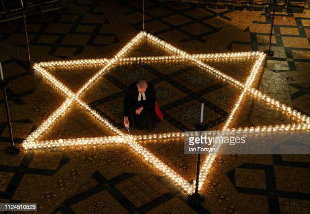 The Reverend Canon Dr Chris Collingwood York Minster's Canon Chancellor lights some of the six hundred candles in the form of the Star of David set...