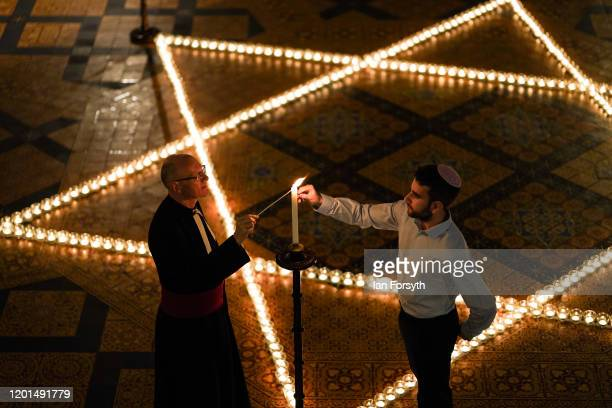 The Reverend Canon Dr Christopher Collingwood Canon Chancellor of York Minster and Joshua Daniels from University of York Jewish Society light some...
