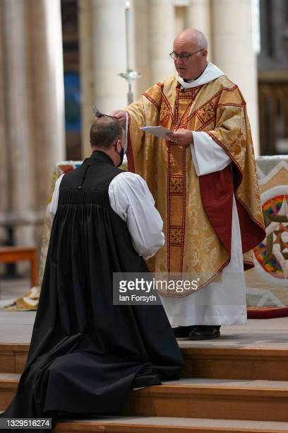 The Reverend Canon Sam Corley , current Rector of Leeds is annointed with oil by the Archbishop of York, The Most Reverend Stephen Cottrell as he is...