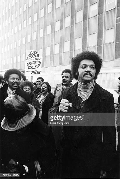 The Reverend Jesse Jackson leader of Operation PUSH leads a group of men and women in protesting against a proposed increase in gas prices Chicago...