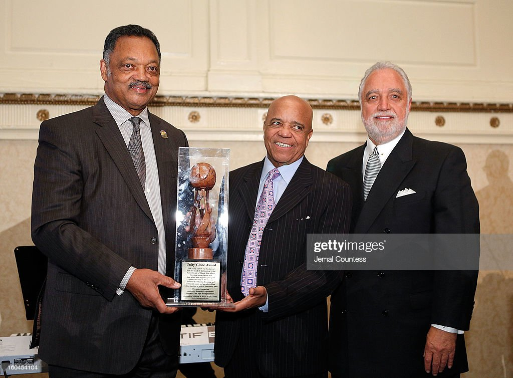 The Reverend Jesse Jackson, record producer and founder of Motown Records Berry Gordy and Chairman and CEO of the Los Angeles Sentinel Danny J. Bakewell, Sr. pose onstage after Berry Gordy is awarded the Unity Globe Award during The 16th Annual Wall Street Project Economic Summit - Day 1 at The Roosevelt Hotel on January 31, 2013 in New York City.
