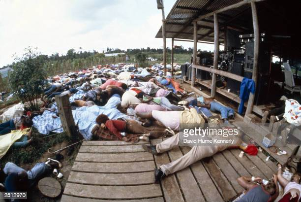 Image depicts death JONESTOWN GUYANA NOVEMBER 18 The Reverend Jim Jones' bloated body lies on the ground along with his followers after it was...