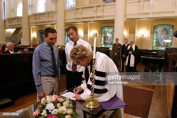 The Reverend Kim K Crawford Harvie senior minister of the Arlington St Church in Boston signs the wedding certificate for a samesex couple Earlier...