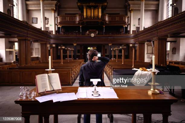 The reverend Lucy Winkett, rector of St James's Piccadilly, attempts to resolve a technical issue, minutes before delivering a service via webcam to...