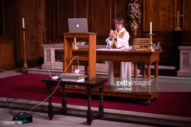 The reverend Lucy Winkett rector of St James's Piccadilly delivers the Eucharist on Rogation Sunday via webcam to the church's congregation while the...