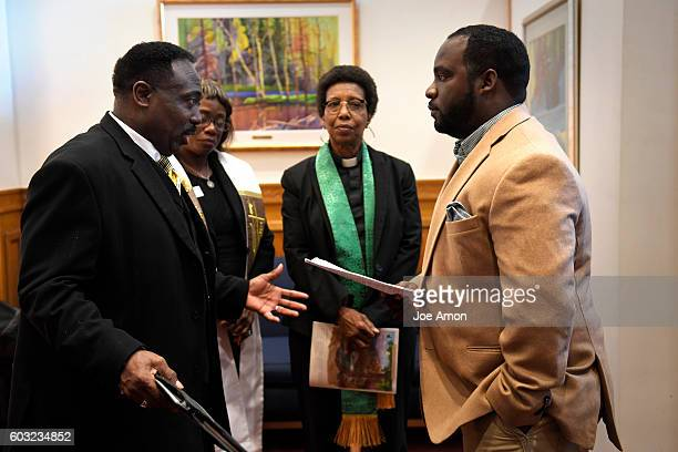 The Reverend Patrick Demmer of the Graham Memorial Community Church of God in Christ delivers a Moral Declaration to Joseph Graves of the office of...