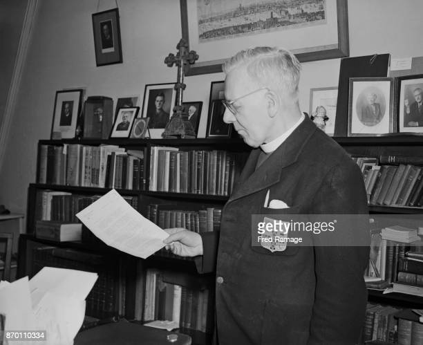 The Reverend Philip Thomas Byard Clayton aka Tubby Clayton reads a letter from Mr C Summer Bird of Boston Massachusetts offering 50 tons of steel for...