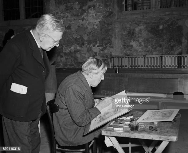 The Reverend Philip Thomas Byard Clayton aka Tubby Clayton watches artist Hanslip Fletcher make a pencil sketch of the work in progress on the North...