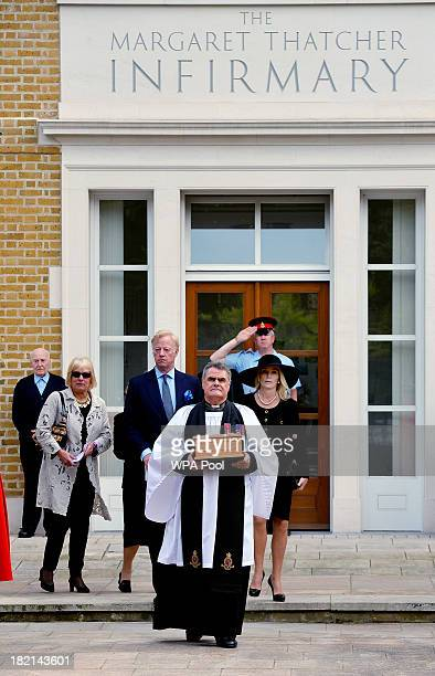 The Reverend Richard Whittington carries a solid oak casket containing the ashes of former British Prime Minister Baroness Margaret Thatcher,...