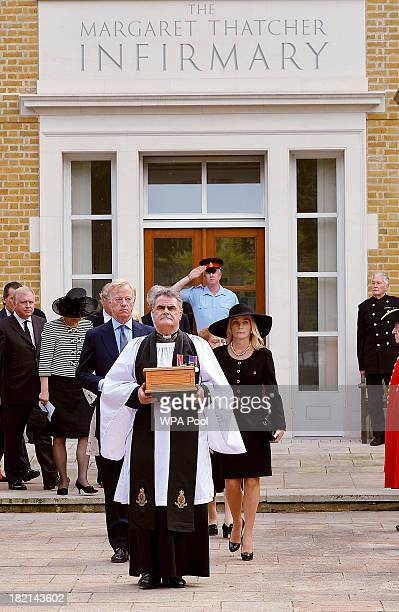 The Reverend Richard Whittington carries a solid oak casket containing the ashes of former British Prime Minister Baroness Margaret Thatcher followed...