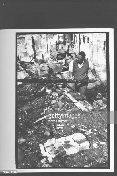 The Reverend Steven Jackson cleaning up the burnt remains of his church the New Bethel Rocky Fork African Methodist Episcopal Church which was burnt...