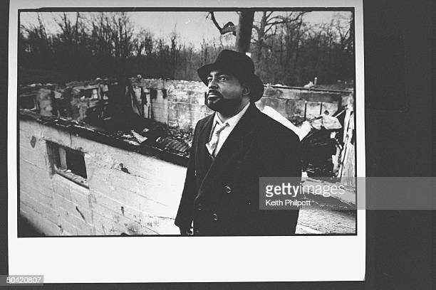 The Reverend Steven Jackson standing in front of the remains of his church the New Bethel Rocky Fork African Methodist Episcopal Church which was...