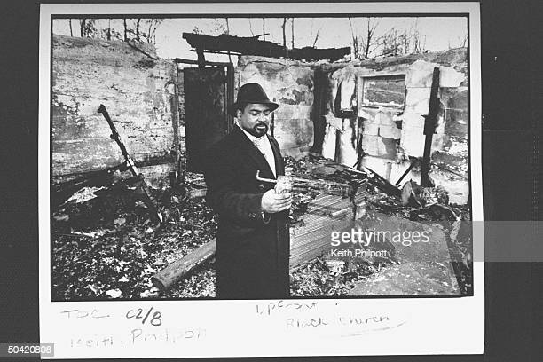 The Reverend Steven Jackson standing inside the remains of his church the New Bethel Rocky Fork African Methodist Episcopal Church which was burned...