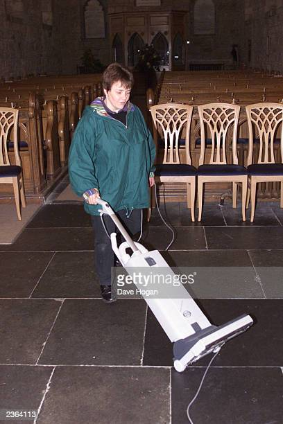 The Reverend Susan Brown cleans up the following morning after the christening of Madonna's son Rocco at Dornoch Cathedral in Scotland Photo Dave...