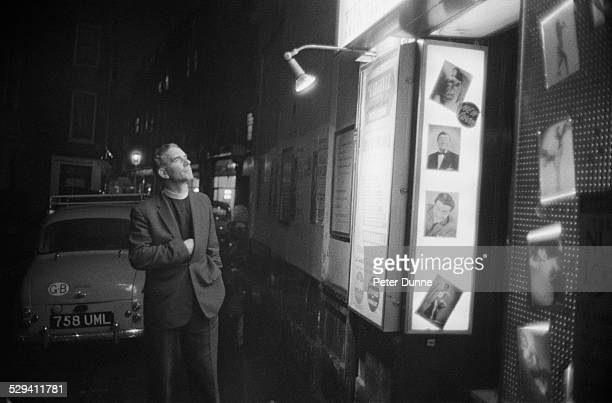 The reverend Vernon Mitchell inspects the images outside a strip club to determine what should be censored Soho London 1st November 1960