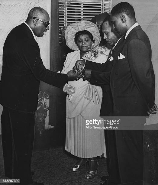 The Reverend Wilbur H Waters a prominent Baltimore citizen and civil rights activist presides at the wedding of musician and radio announcer Milton...
