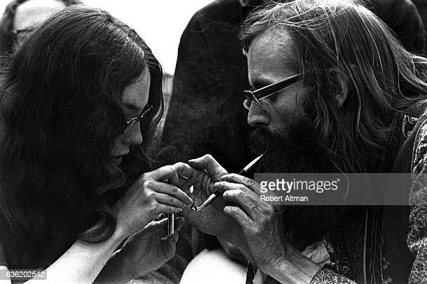 The Reverend Wilbur Leo Minzey of The Shiva Fellowship Church Earth Faire smokes with a lady on April 16 1969 at Golden Gate Park in San Francisco...