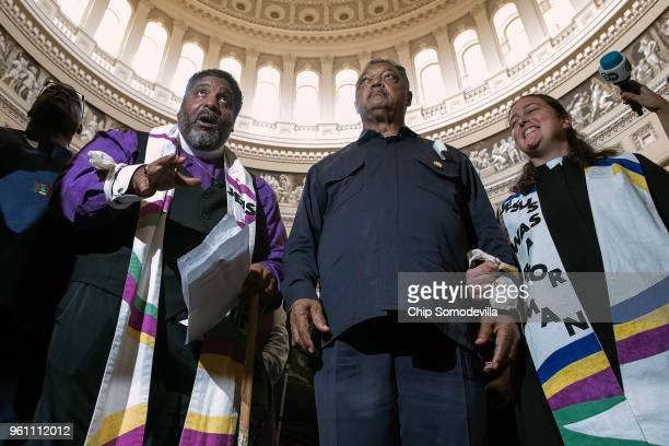 The Reverend William Barber and The Reverend Jesse Jackson lead protesters through the US Capitol Rotunda before being arrested May 21 2018 in...