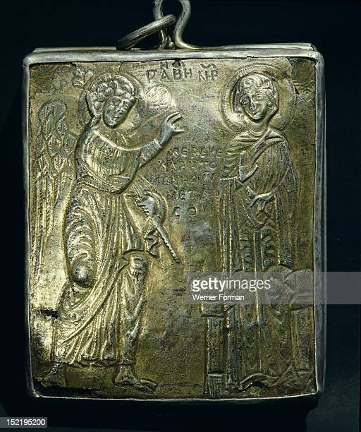 The reverse of the small gold and enamel reliquary with a figure of the Virgin Mary on one side and the Annunciation on the reverse It was brought as...