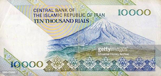 The reverse side of a ten thousand Rial banknote depicting Mount Damavand a stratovolcano which is the highest peak in Iran This peak is located in...