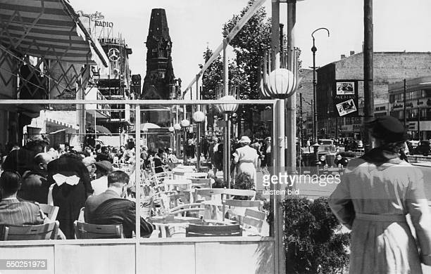The revived shopping mile in the Tauentzienstraße in the backt the Kaiser Wilhelm Memorial Church Vintage property of ullstein bild Photo by Reich...