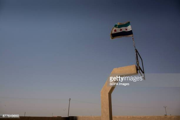 The revolutionary flag of a Free Syria flies from a basketball ring of a school The school is used as a training camp for Quwat Al Nukhba to train in...
