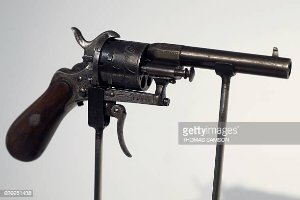 The revolver with which French poet Paul Verlaine tried to kill his lover Arthur Rimbaud is displayed at Christie's auction house before the most...