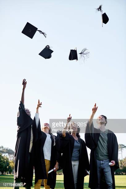the rewards are all worth the effort - alumni stock pictures, royalty-free photos & images