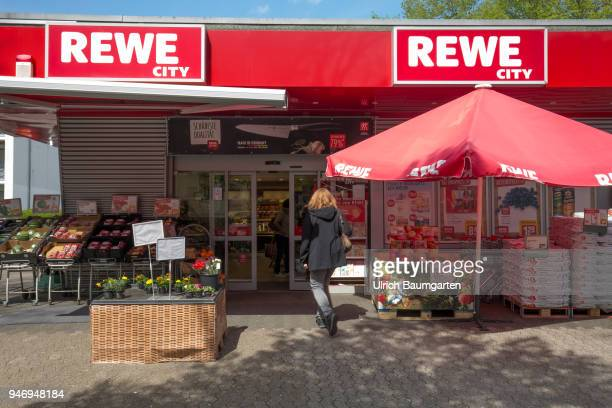 The Rewe Group is a German trading and tourism company Exterior view of a food supermarket with the Rewe logo