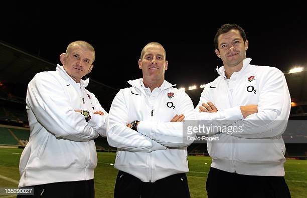 The RFU interim coaching team of Stuart Lancaster head coach Andy Farrell the backs coach and Graham Rowntree the forwards coach pose after at press...