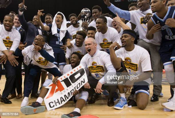 The Rhode Island Rams celebrate after the game against the Virginia Commonwealth Rams in the Championship game of the men's Atlantic 10 tournament at...
