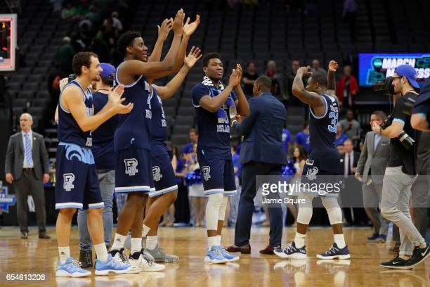 The Rhode Island Rams celebrate their victory over the Creighton Bluejays during the first round of the 2017 NCAA Men's Basketball Tournament at...