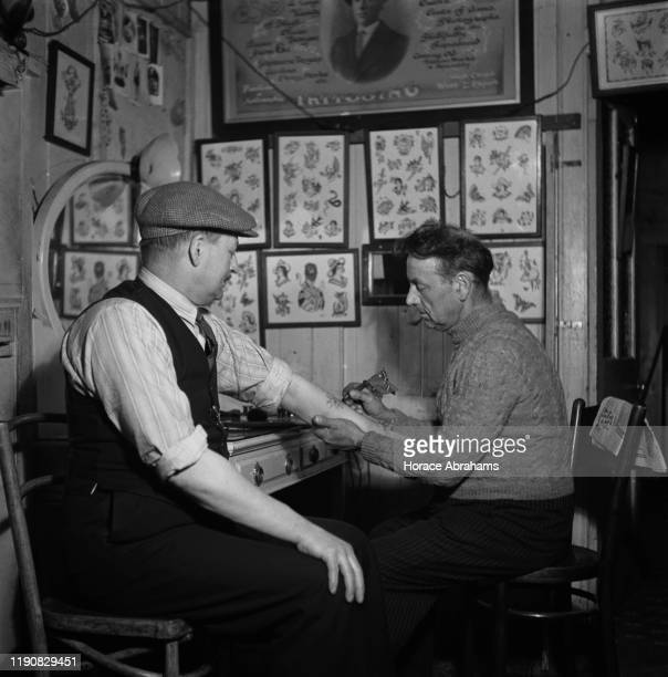 The Rhodes tattoo parlour in Dover, Kent, England, June 1941.