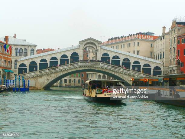 The Rialto Bridge spanning the Grand Canal in Venice Italy It is the oldest bridge across the canal The present stone bridge was designed by Antonio...