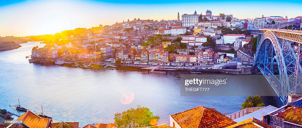 The Ribeira in Porto with a sunset and sunflare : Stock Photo