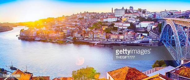 The Ribeira in Porto with a sunset and sunflare