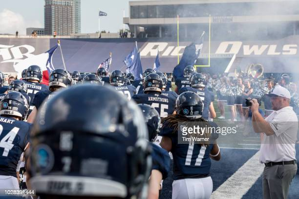 The Rice Owls take the field before the game against the Prairie View AM Panthers at Rice Stadium on August 25 2018 in Houston Texas
