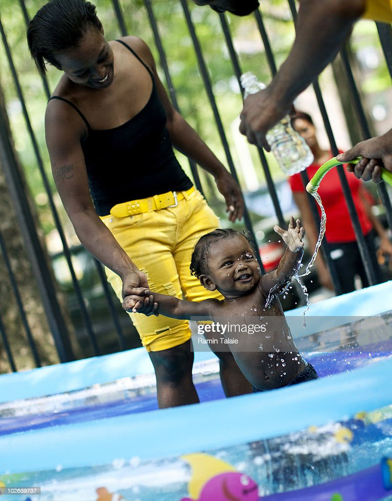 The Richardson family of Brooklyn play in an inflatable pool near their apartment on July 6, 2010 in the Brooklyn borough of New York City. The National Weather Service has issued a heat advisory for parts of the Northeast, mid-Atlantic and parts of Michigan and Kentucky with temperatures in some areas predicted to reach 100 degrees.
