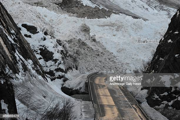 The Richardson Highway near Mile 16 is buried under debris from a massive avalanche in Snowslide Gulch right near Keystone Canyon and the Lowe River...