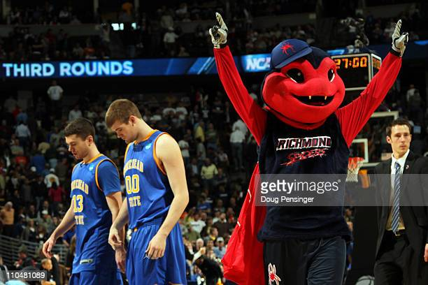 The Richmond Spiders mascot celebrates after the game as Ty Proffitt and Drew Kelly of the Morehead State Eagles walk off the court during the third...
