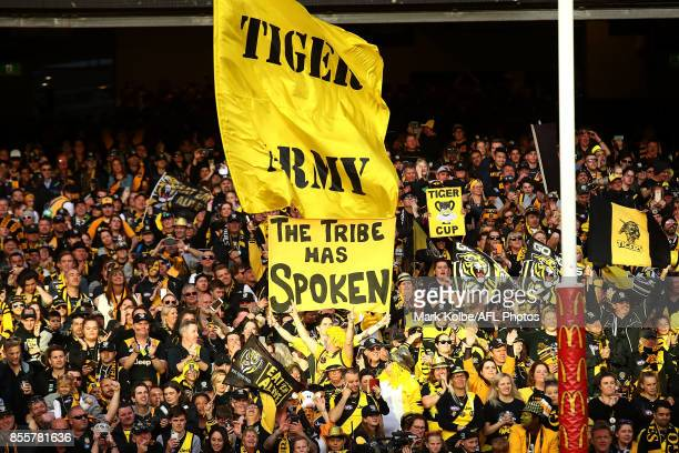 The Richmond Tigers supporters celebrate victory during the 2017 AFL Grand Final match between the Adelaide Crows and the Richmond Tigers at...