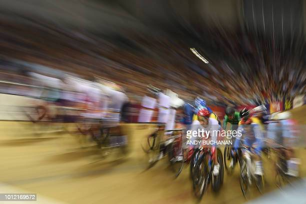 TOPSHOT The riders compete in the women's omnium elimination race of the track cycling at the Sir Chris Hoy velodrome during the 2018 European...