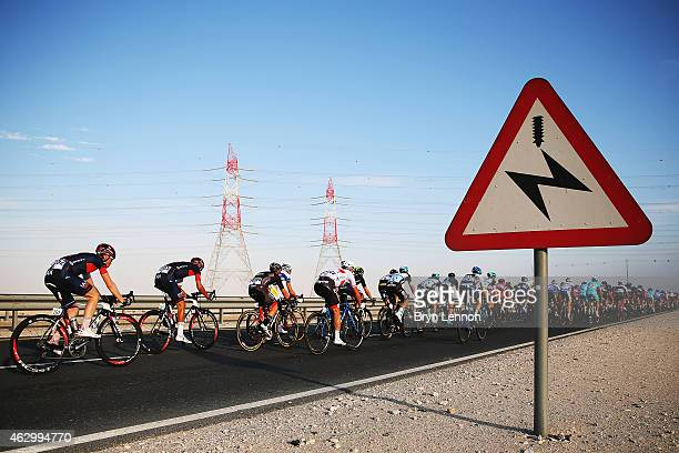 The riders make their way down the highway on stage one of the 2015 Tour of Qatar from Dukhan to Sealine Beach on February 8, 2015 at Sealine Beach,...